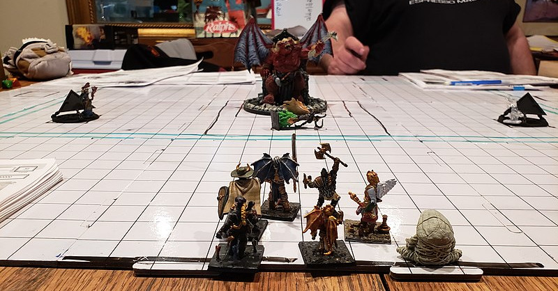 Miniatures on a grid board utilized for a Dungeons and Dragons game in La Mesa, California